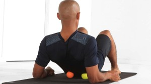 Lower back stretch on balls